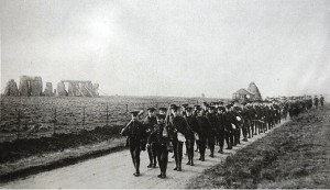 Canadian soldiers marching past Stonehenge