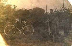 John Unwin photo in uniform with bicycle