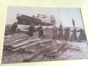 Women pulling lifeboat